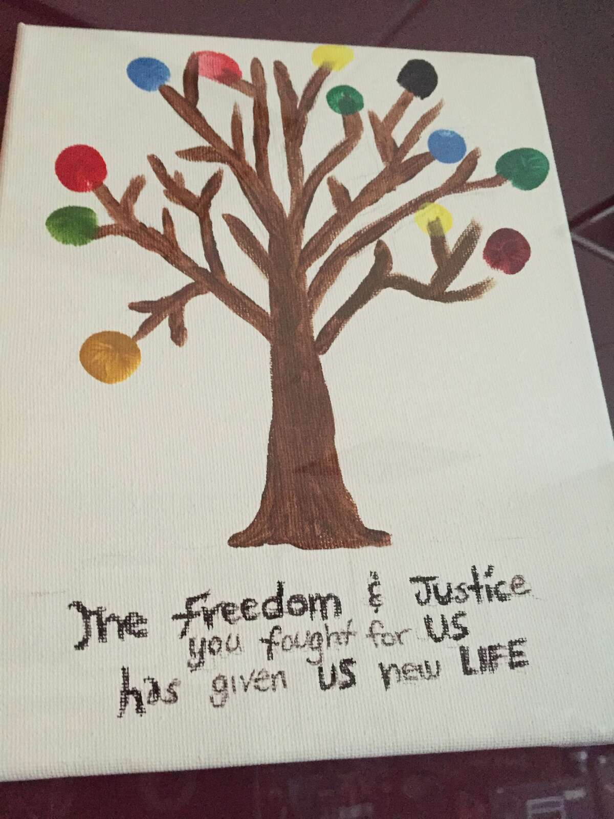 This painting was made by victims of a Houston brothel based sex-trafficking ring and presented to prosecutors and an investigator as a thank you. The colored bulbs on the tree are made with fingerprints from each of a dozen women who testified against the ring's leader, who was sentenced to life in prison.