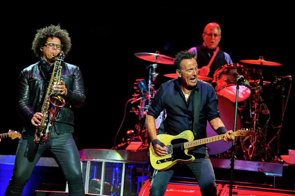 Bruce Springsteen, center, Max Weinberg, and Jake Clemons, left, perform with the E Street Band at Madison Square Garden, Wednesday, Jan. 27, 2016, in New York. (Photo by Robert Altman /Invision/AP) ORG XMIT: NYRA106