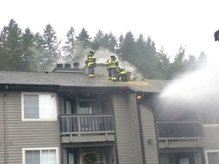 Kent firefighters tackled an apartment fire Thursday morning that may have been set by the resident of the burned apartment. The resident and two men who pulled him out of the unit suffered smoke inhalation injuries. / 2016