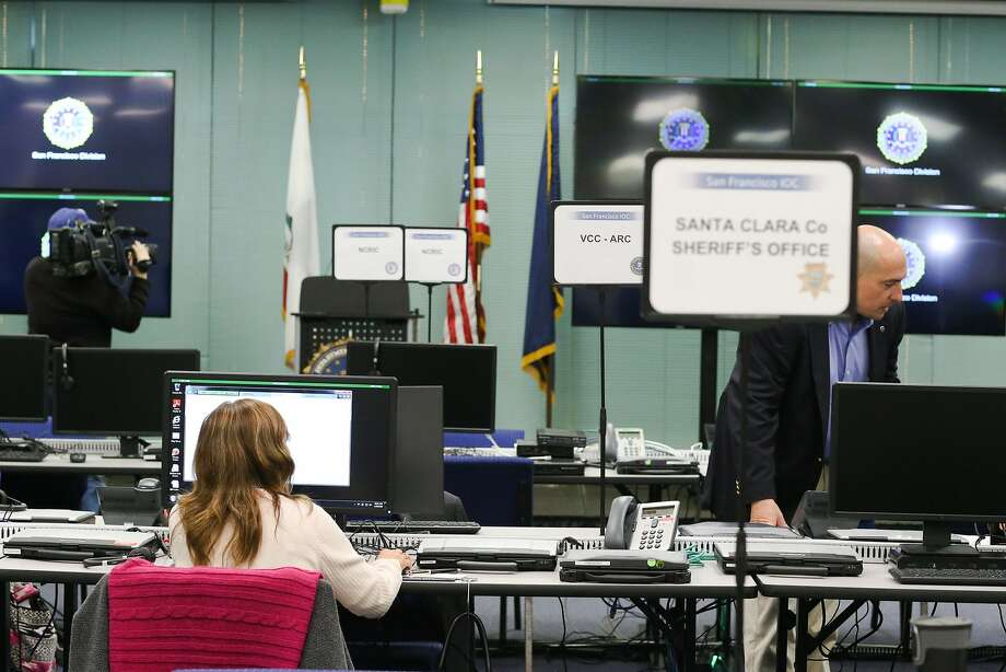 FBI personnel pose at computers at the FBI Super Bowl Joint Operation Center in Mountain View, Calif on Thursday, Jan. 28, 2016. The FBI Super Bowl Joint Operation Center will monitor the Bay Area the week of the Super Bowl Photo: James Tensuan, The Chronicle