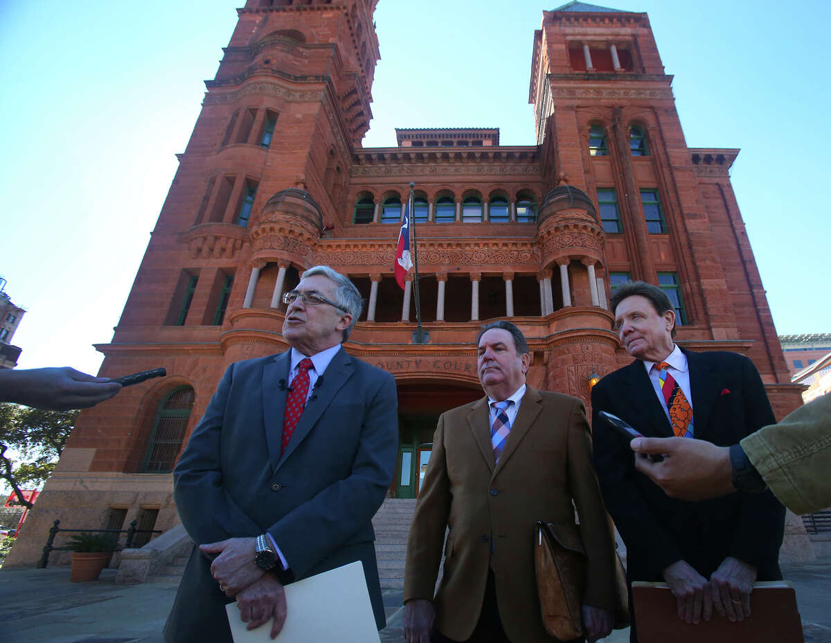 Attorneys Allan E. Parker, (left) George LeGrand (center) and Stanley Bernstein (right) stand in front of the Bexar County Courthouse Thursday January 28, 2016 during a press briefing at which they announced their client is suing Tom Benson Chevrolet and Ernesto Davila, who at the time was her manager. Their client, Stephanie Cordero, alleges that Davila coerced her into having an abortion.