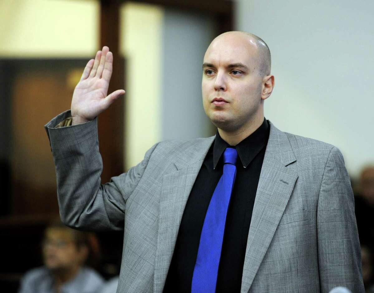 Matthew Mills, 32, of Brooklyn, N.Y., appears before Superior Court Judge William Holden in Bridgeport Tuesday, Nov. 17, 2015, on a charge of interfering with police and second-degree breach of peace for allegedly trying to disrupt the annual charity race in honor of murdered Sandy Hook teacher Victoria Soto.