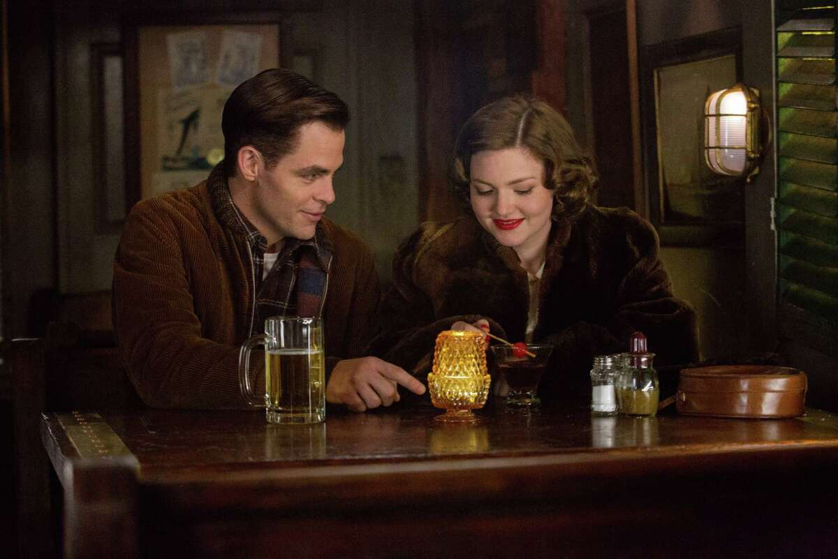 """In this image released by Disney, Chris PIne, left, and Holliday Grainger appear in a scene from, """"The Finest Hours,"""" a heroic action-thriller based on the true story of the most daring rescue in the history of the Coast Guard. (Claire Folger/Disney via AP) ORG XMIT: NYET110"""