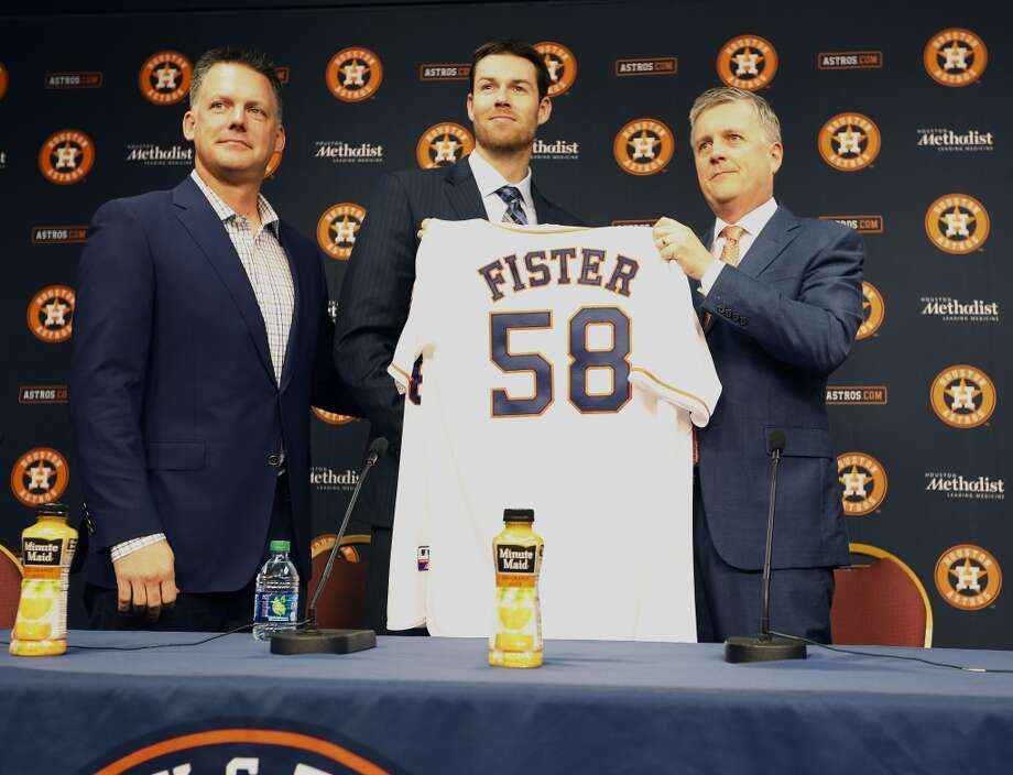 Astros Manager A.J. Hinch (l-r), free agent right-hand pitcher Doug Fister and General Manager Jeff Luhnow Thursday, Jan. 28, 2016, in Houston. ( Steve Gonzales  / Houston Chronicle  ) Photo: Steve Gonzales, Houston Chronicle