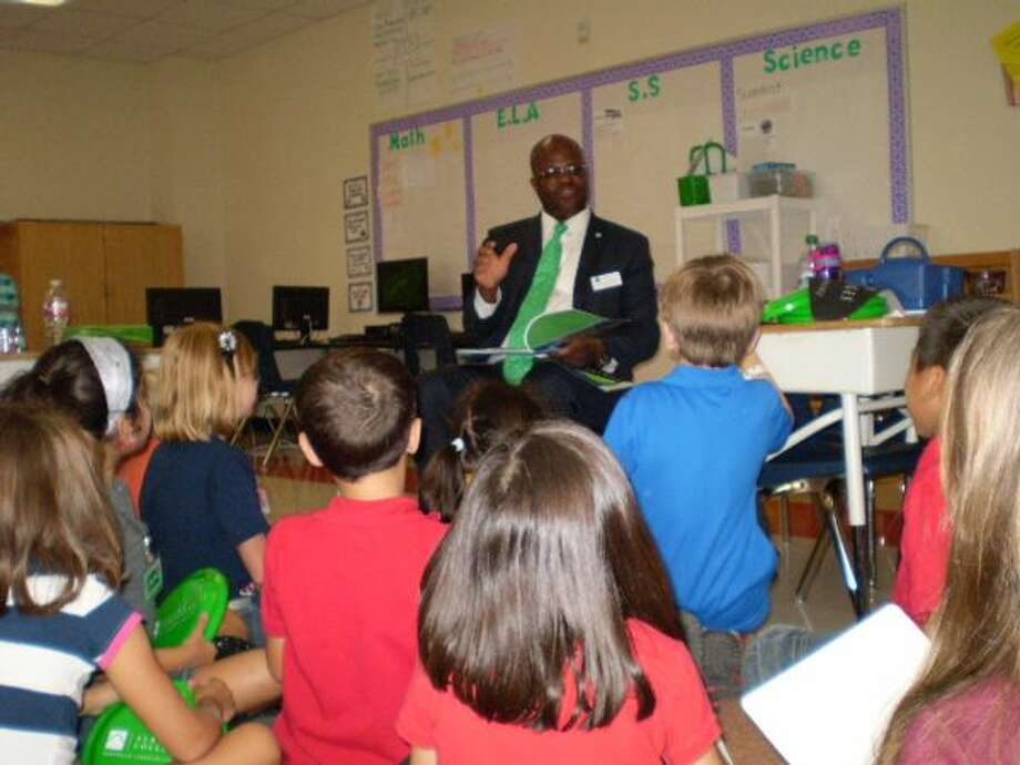 In this file photo, former Northeast Lakeview College President Craig Follins visits witha local second-grade class to talk about going to college. Follins has been reassigned, but Alamo Colleges officials will not say why. Photo: /Photo Courtesy Of Judson ISD