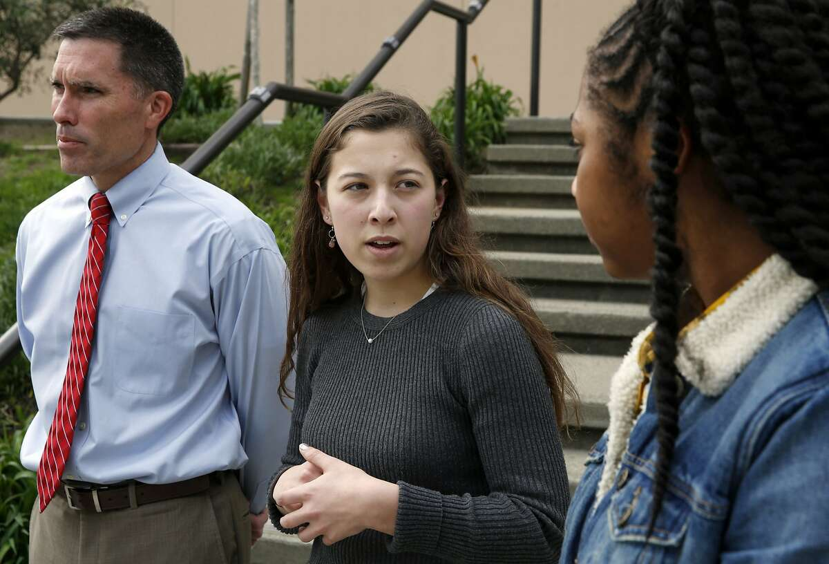Principal Patrick Ruff (left), Lizzie Ford, student body president, and Nahrie Pierce, president of the black student union, speak to a reporter outside St. Ignatius College Preparatory High School in San Francisco, California, on Thursday, Jan. 28, 2016.