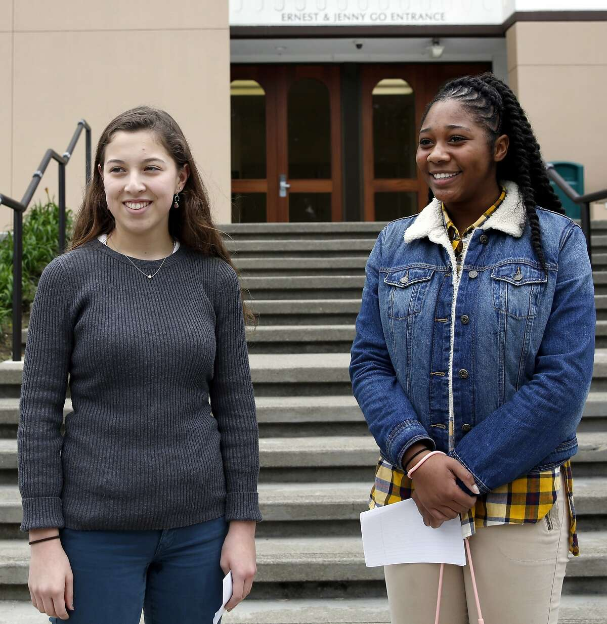 Lizzie Ford (left), student body president, and Nahrie Pierce, president of the black student union, stand outside St. Ignatius College Preparatory High School in San Francisco, California, on Thursday, Jan. 28, 2016.