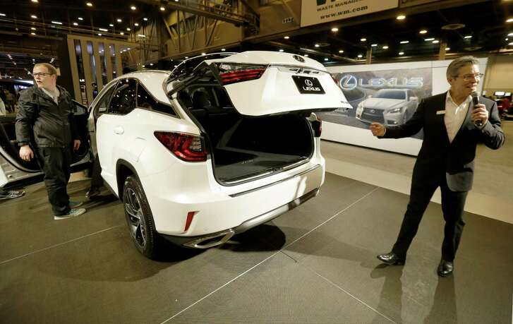 A Lexus RX 350 is shown on display at the Houston Auto Show at NRG Center. The RX has a motion- activated trunk door that allows hands-free opening.