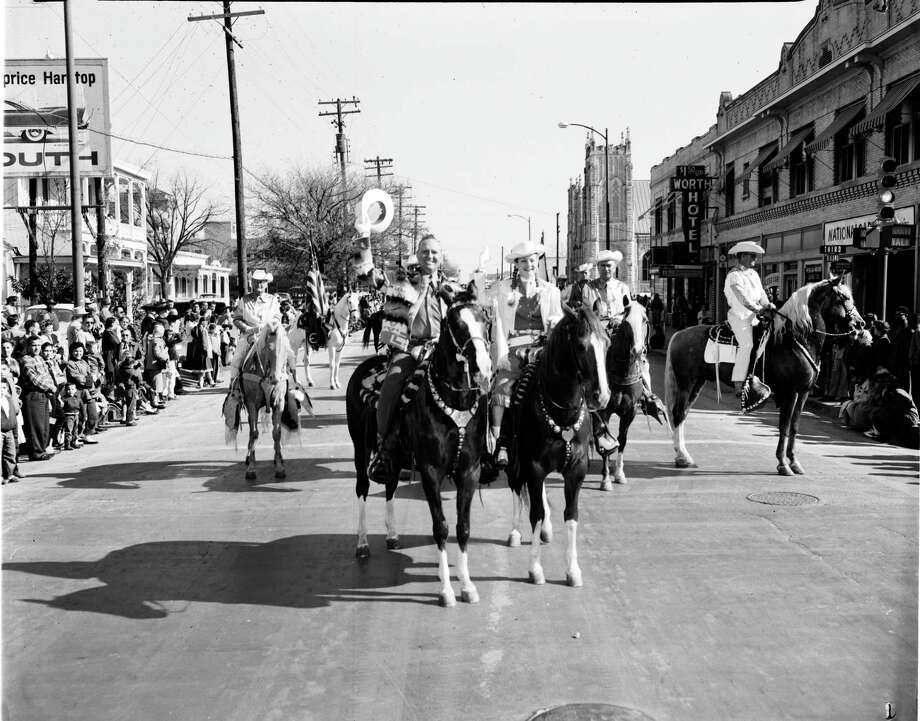 "Gene Autry and Gail Davis ""Annie Oakley"" lead the western parade that officially opens the Stock Show and Rodeo, Feb. 7, 1958. Photo: Courtesy UTSA Special Collections / Zintgraff Collection"