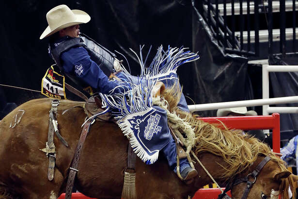 Jesse Wright, from Milford, Utah, competes in the saddle bronc riding event during the 66th annual San Antonio Stock Show & Rodeo Feb. 19, 2015, at the AT&T Center. Wright scored a 65 on his ride.