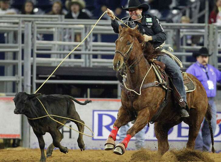 Trevor Brazile ropes a calf during the tie-down competition during the Houston Livestock Show and Rodeo at NRG Stadium on March 10, 2015, in Houston.