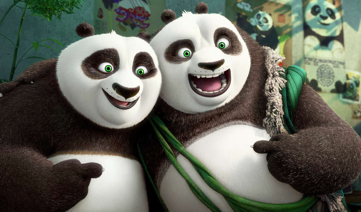"""Po (left, voiced by Jack Black) and his long-lost panda father Li (voiced by Bryan Cranston) pose for a portrait in """"Kung Fu Panda 3."""""""