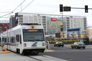 A Light Rail train passes Levi's Stadium in Santa Clara, Calif. on Thursday, Jan. 28, 2016. VTA has the challenge of moving 70,000 people to and from Levi's stadium the day of the Super Bowl.