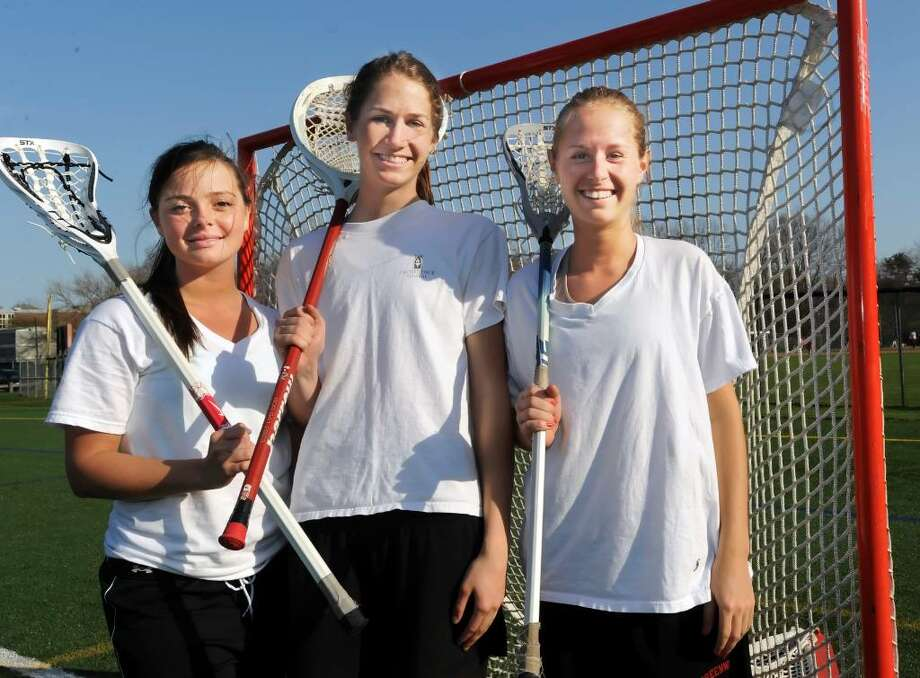 Greenwich High School girls lacrosse captains, from left: Katie Read, Kaitlin Bradford, and Sarah Kramer on the Greenwich High School athletic fields on Monday, April 5, 2010. Photo: Helen Neafsey / Greenwich Time