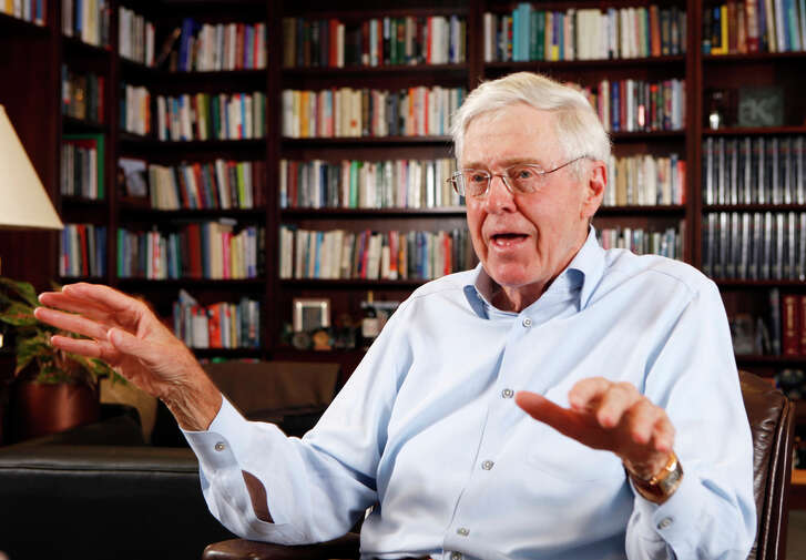 """In this May 22, 2012, file photo, Charles Koch speaks in his office at Koch Industries in Wichita, Kan. Koch, a billionaire industrialist, warned America is """"done for"""" if the conservative donors and politicians he gathered at a retreat this weekend don't rally others to their cause of demanding a smaller, less-intrusive government. (Bo Rader/The Wichita Eagle via AP, File) LOCAL TELEVISION OUT; MAGS OUT; LOCAL RADIO OUT; LOCAL INTERNET OUT; MANDATORY CREDIT"""