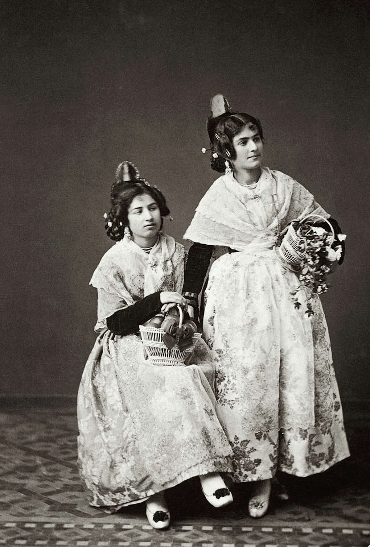 1800s Two Spanish women in traditional clothing, circa 1890.