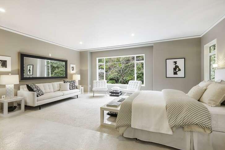 The spacious master suite enjoys garden views.