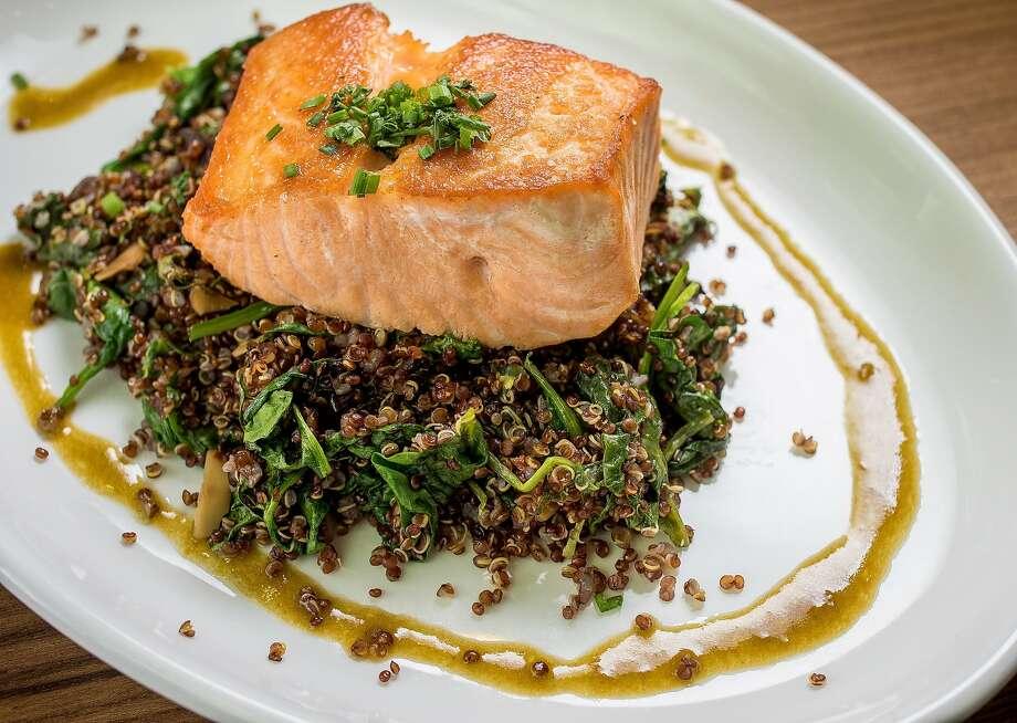 Salmon accompanies quinoa at Little Gem in S.F. Photo: John Storey