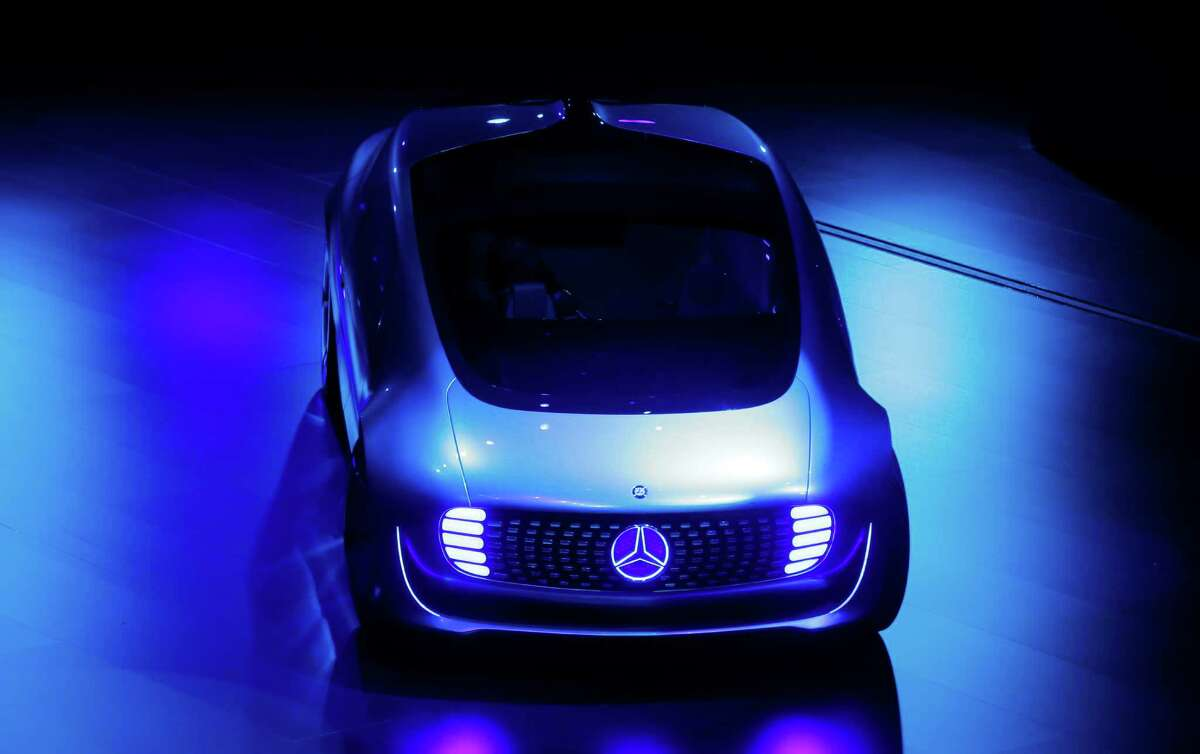 An autonomous driving vehicle Mercedes F 015 appears on stage during an event of the Daimler group on the eve of the Frankfurt Auto Show IAA in Frankfurt, Germany, Monday, Sept. 14, 2015. (AP Photo/Michael Probst)