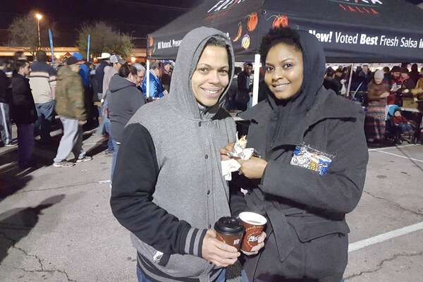 Victoria Abrams (left), a regular at the annual Cowboy Breakfast, brought first-timer Vashawn Martin-Abrams with her to this morning's breakfast, the annual kick-off to the San Antonio Stock Show and Rodeo.