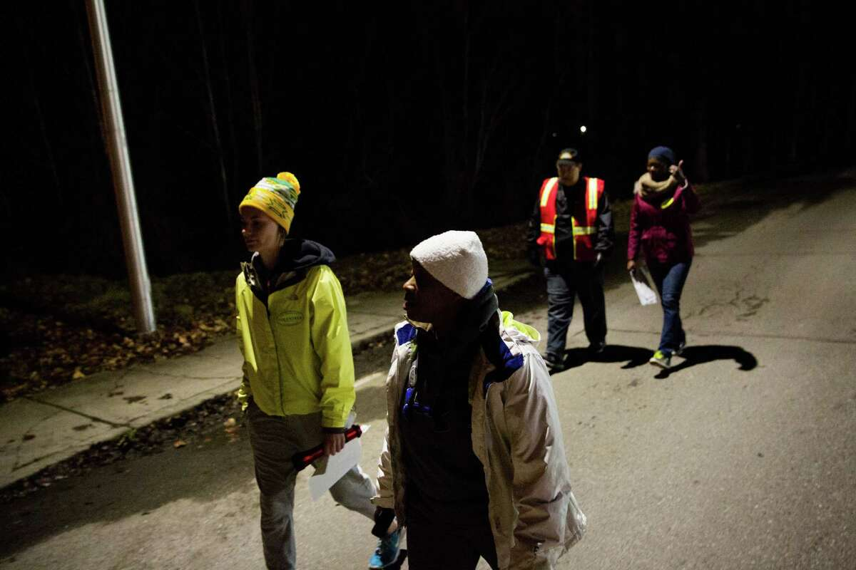 Kelsi Tyler, Tewana Martin, Dave Mitchell and Malory Gustave-Trask roam their designated area in Kent during the Coalition on Homelessness 2016 One Night Count on Friday, Jan. 29, 2016. Hundreds volunteer every year to count the number of people that are homeless for use as a bench mark for aid, services, and the prevalence of the problem.