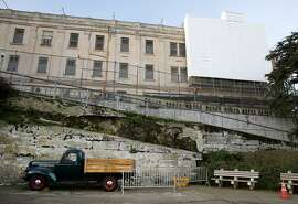 Protective wrapping covers the northwest corner of the main cell block on Alcatraz Island in San Francisco, Calif. on Wednesday, Jan. 27, 2016, one of many restoration projects underway. A section of the western end of the main cell block will be encased in scaffolding and covered with a protective white skin while extensive repairs are performed on the decaying exterior.