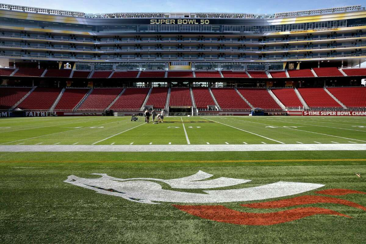 Logo The Denver Broncos logo is all set while workers paint the NFL logo onto the 50-yard-line as preparations for Super Bowl 50 continue at Levi's Stadium on Tues. January 26, 2016, in Santa Clara, Calif.