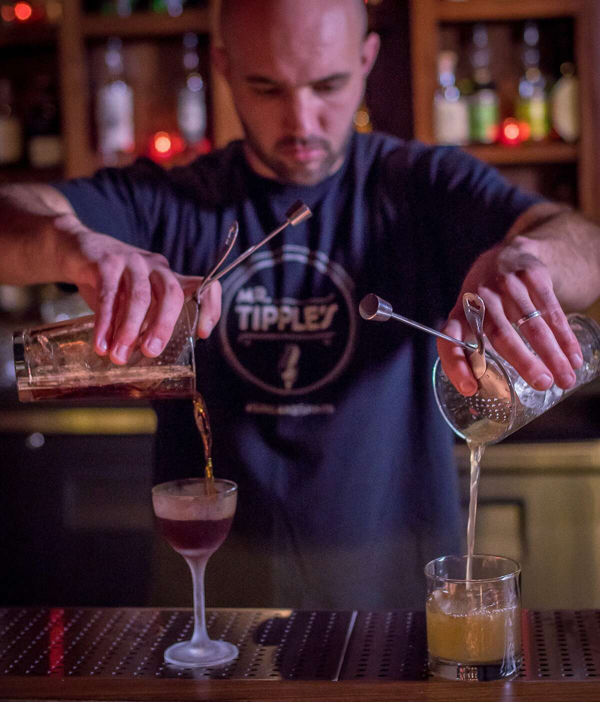 Bar director Chase Williamson crafts cocktails at Mr. Tipples in S.F.