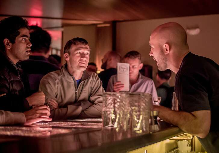 Bar Director Chase Williamson talks with customers about cocktails at Mr Tipple's in San Francisco, Calif., on Thursday, January 28th, 2016.