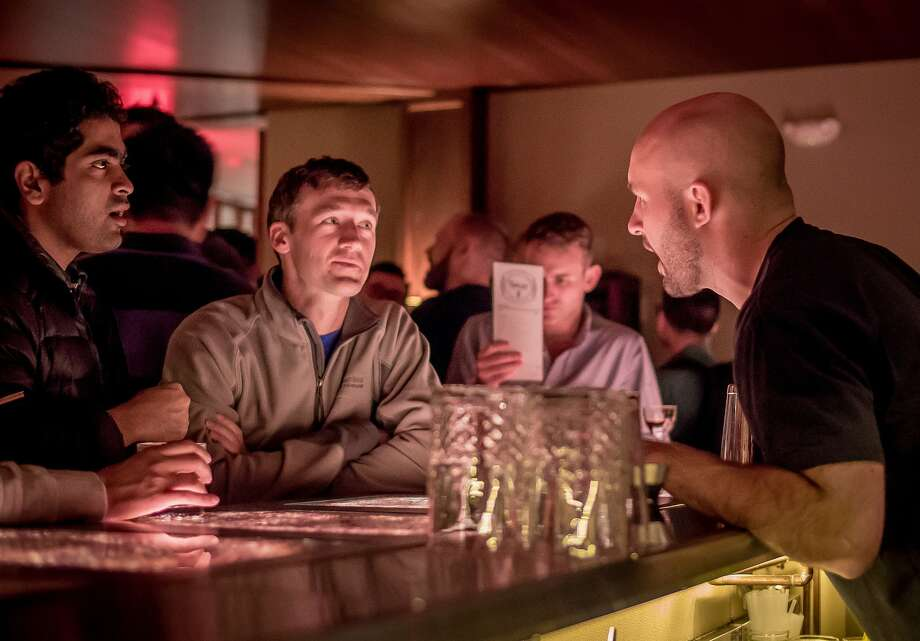Bar director Chase Williamson chats with customers about cocktails at Mr. Tipple's in S.F. Photo: John Storey