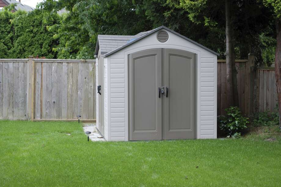 backyard shed with primitive toilet renting over super