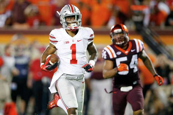 Ohio State wide receiver Braxton Miller  #1 of the Ohio State Buckeyes runs for a 53-yard touchdown in the third quarter against the Virginia Tech Hokies at Lane Stadium on September 7, 2015 in Blacksburg, Virginia. (Photo by Joe Robbins/Getty Images)