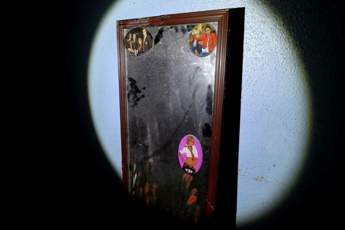 A mirror with smeared lipstick and stickers in a room where girls under 18 were held under pad locked doors and prostituted against their will at Las Palmas II on Telephone Road. The site is one of the largest sex-trafficking rings ever busted in Houston.