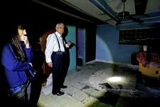 Shauna Dunlap, left, special agent Houston office of the FBI, shown with Ruben Perez, assistant United State Attorney Chief, civil rights/human trafficking unit, in a second floor room where girls under 18-years-old were held under pad locked doors and prostituted against their will at Las Palmas II, along the 5600 block of Telephone Road. The club was a former cantina and brothel, where Mexican and Central American women were held against their will, and subjected to beatings, rape and threats of further abuse if they didnâÄôt work as prostitutes Wednesday, Nov. 18, 2015, in Houston, Texas. They worked and lived in rooms above the bar, which was downstairs and drew thousands of customers. The site is one of the largest sex trafficking rings ever busted in Houston.