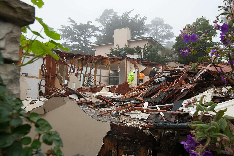 Construction workers demolish the building located at 256 Casitas Ave. in the Mount Davidson area, Friday, Jan. 29, 2016, in San Francisco, Calif. The building, that was purchased just a few months ago, was demolished after it started to slide down the hill. Photo: Santiago Mejia, Special To The Chronicle