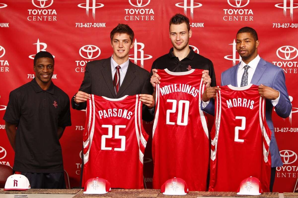 Newly acquired player, Jonny Flynn (left to right) stands next to Houston Rocket's 2011 NBA Draft picks, Chandler Parsons, Donatas Motiejunas, and Marcus Morris during a press conference at the Toyota Center, Friday, June 24, 2011, in Houston. ( Michael Paulsen / Houston Chronicle )