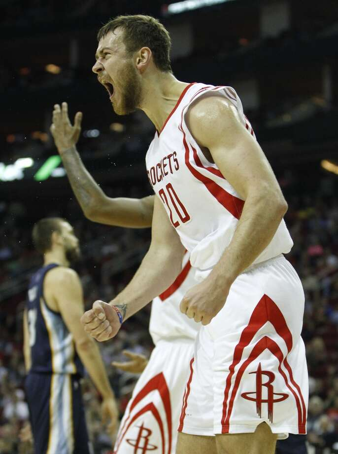 Houston Rockets forward Donatas Motiejunas (20) reacts after being fouled by Memphis Grizzlies guard Courtney Lee (5) on his way to the basket in the first half of an MBA basketball game at Toyota Center, Wednesday, Dec. 3, 2014, in Houston.  ( Karen Warren / Houston Chronicle  ) Photo: Houston Chronicle