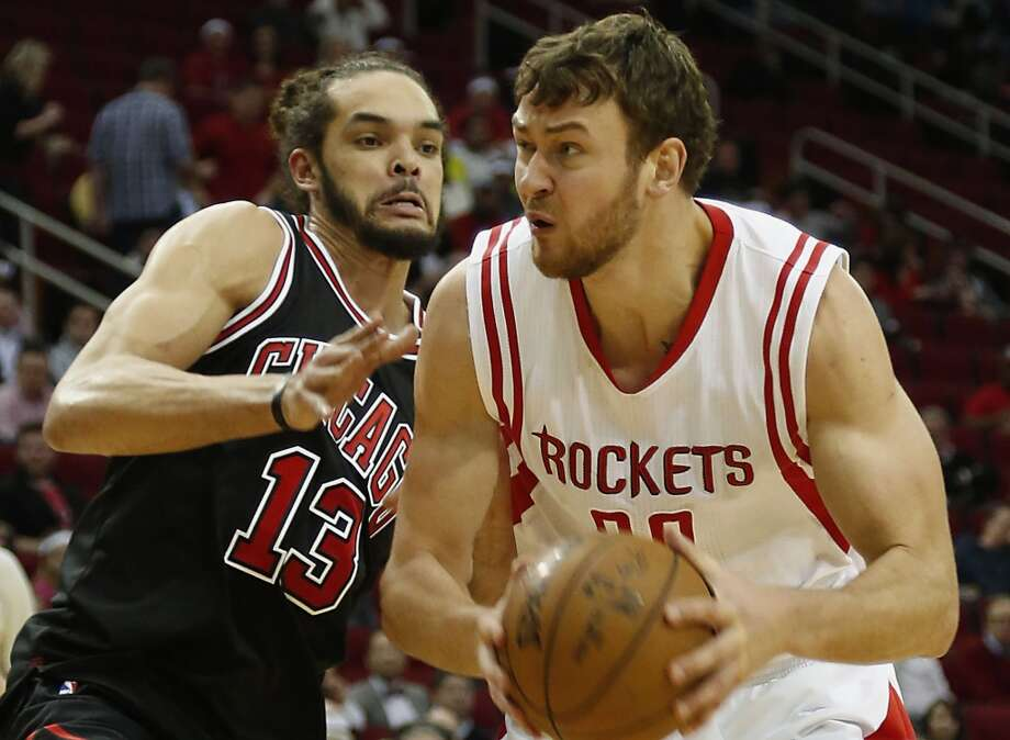 Donatas Motiejunas (right) is heading to Detroit after being sidelined for most of this season with a back injury. Photo: Houston Chronicle