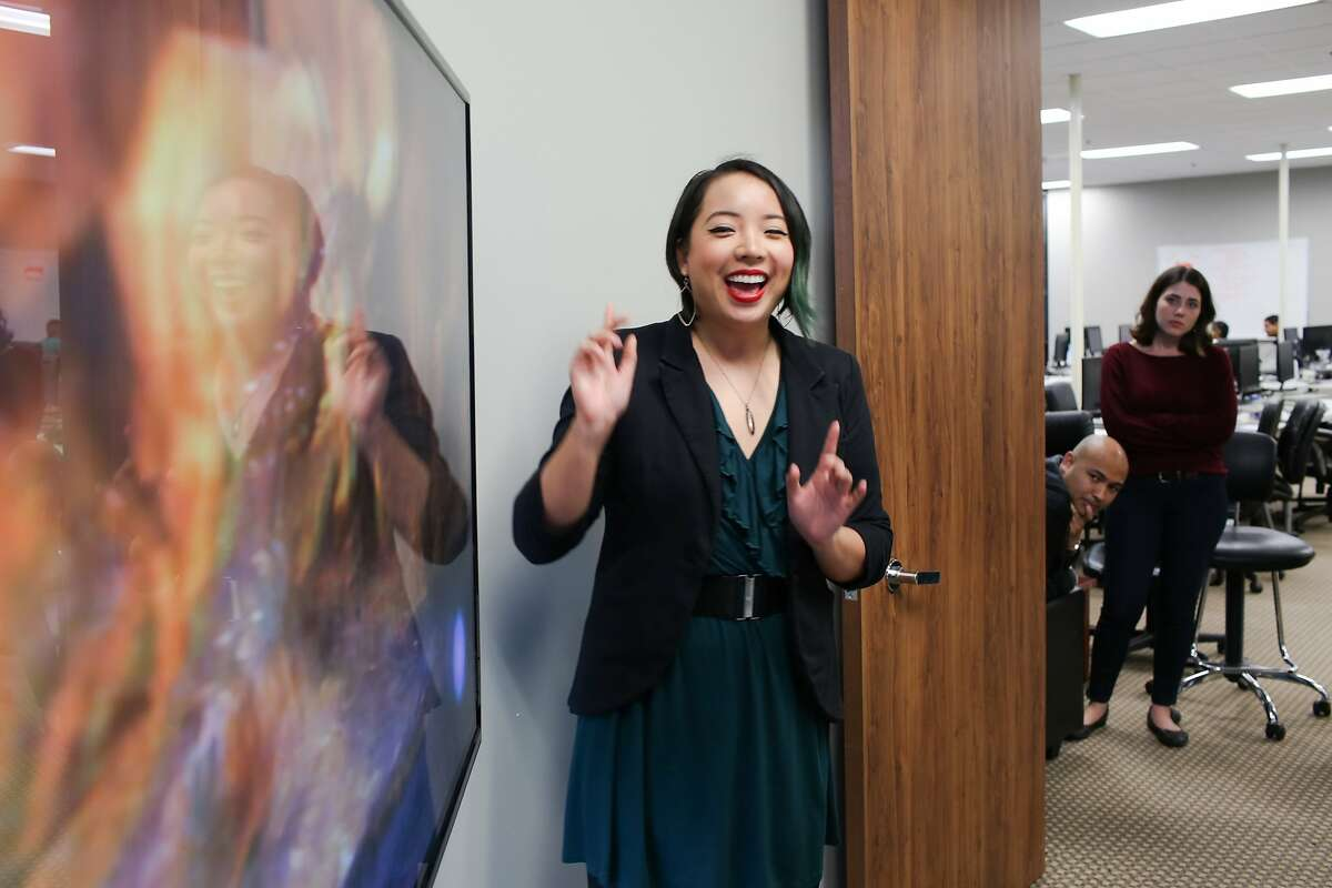 Danielle Leong reacts to a nature documentary as she presents her app Feerless at Coding Dojo in San Jose, Calif. on Friday, Jan. 30, 2016. The Google Chrome extension warns viewers of potentially disturbing content.
