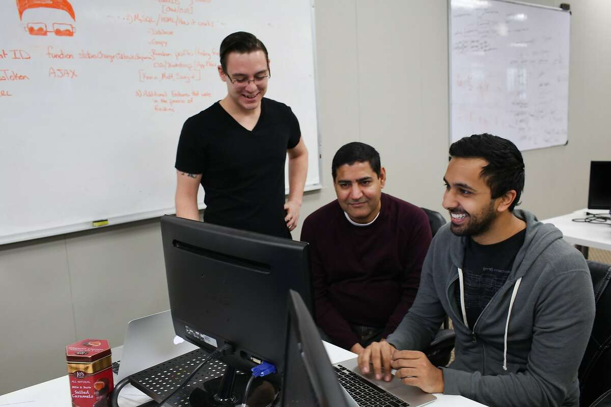 Left to right, Chad Fegley, Sanjiv Sharma and Kerrin Arora work on a project at Coding Dojo in San Jose, Calif. on Friday, Jan. 30, 2016. The Google Chrome extension warns viewers of potentially disturbing content.