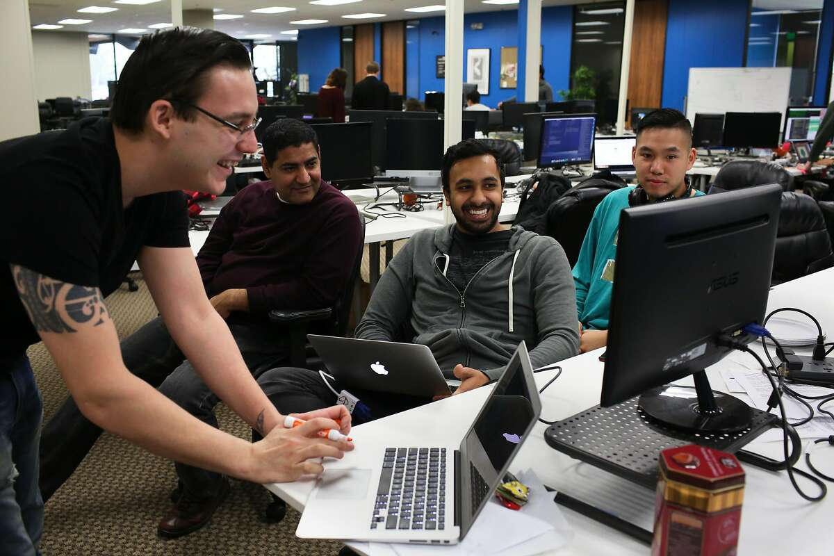 Left to right, Chad Fegley, Sanjiv Sharma, Kerrin Arora and Matthew Nguyen work on a project at Coding Dojo in San Jose, Calif. on Friday, Jan. 30, 2016. The Google Chrome extension warns viewers of potentially disturbing content.