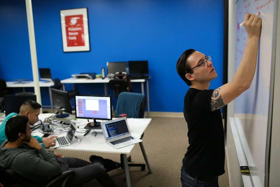 Chad Fegley works on a project at Coding Dojo in San Jose, Calif. on Friday, Jan. 30, 2016. The Google Chrome extension warns viewers of potentially disturbing content. Photo: James Tensuan, The Chronicle