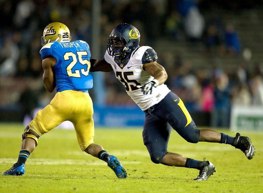 This Oct. 12, 2013 photo released by GoldenBearSports.com shows California's Ted Agu, right, tackling UCLA's Damien Thigpen, in Pasadena, Calif. Agu died Feb. 7, 2014 at age 21. Photo: Michael Pimentel, Associated Press