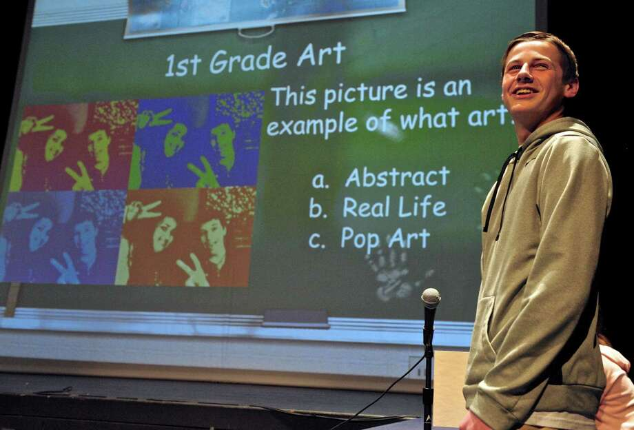 "New Milford High School junior Kory Cyr, 16, looks to the audience for help with a question as he competes with 5th graders from Sarah Noble Intermediate School during a round of ""Are You Smarter Than A Fifth Grader"" presented by NMHS DECA. Thursday night, January 28, 2016, in New Milford. Photo: H John Voorhees III / Hearst Connecticut Media / The News-Times"
