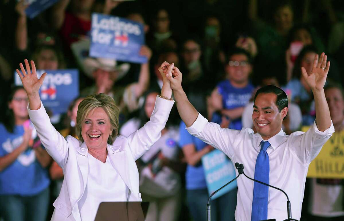 Presidential candidate Hillary Clinton, left, and former Mayor Julian Castro greet supporters at a rally on Thursday, Oct. 15, 2015 at Sunset Station in San Antonio.