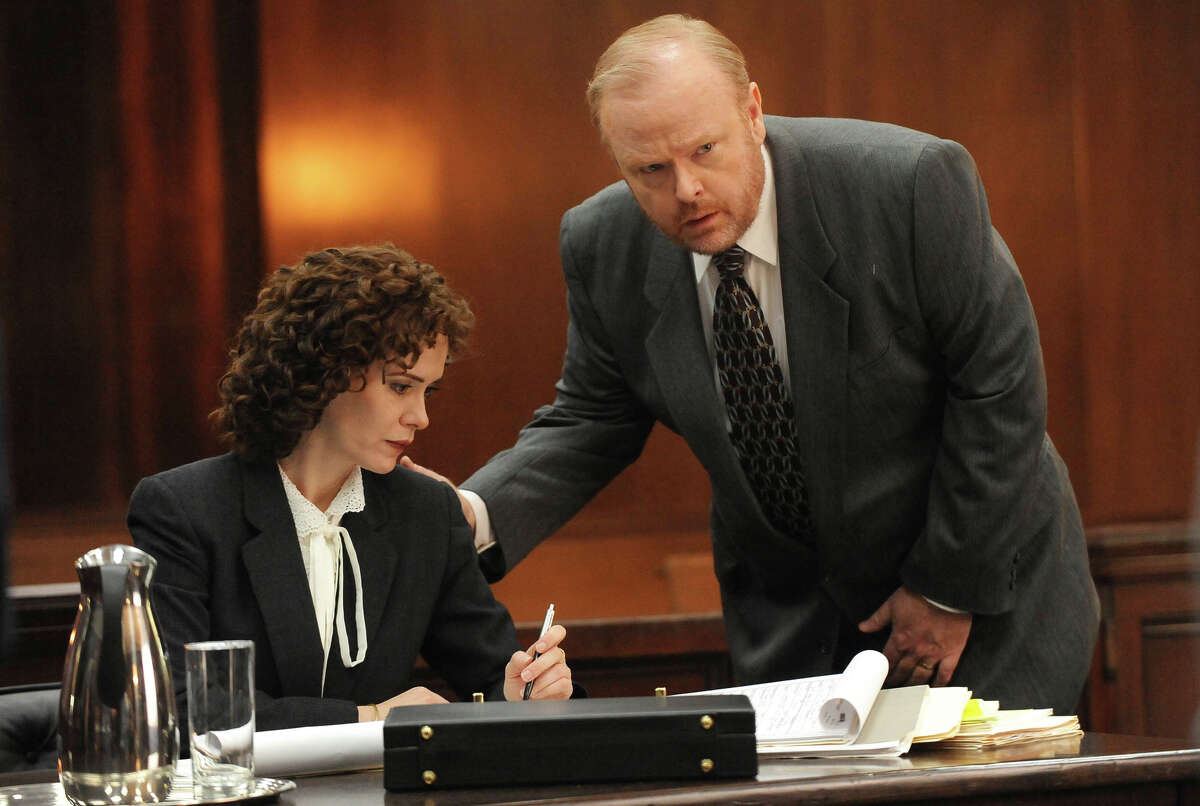Re-created onscreen: Sarah Paulson as Assistant District Attorney Marcia Clark, Christian Clemenson as Bill Hodgman.