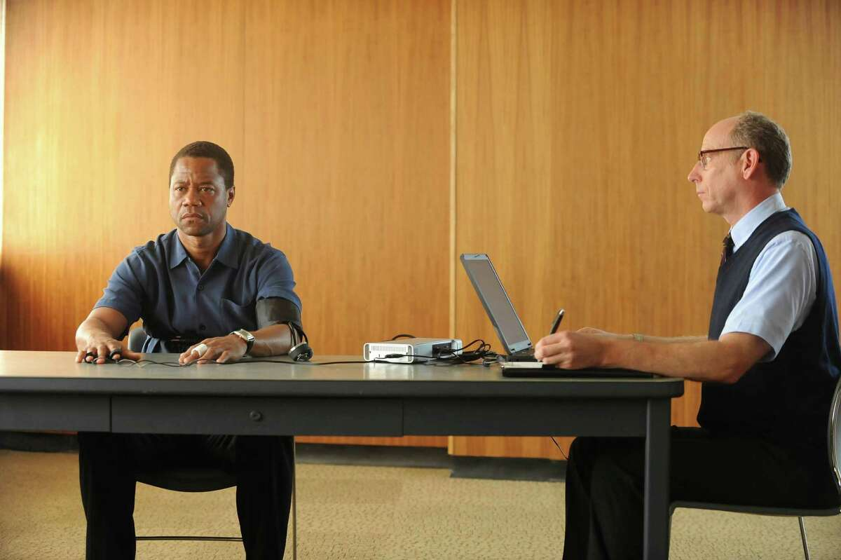 Cuba Gooding Jr. (left) as O.J. Simpson, taking his polygraph examination with Joseph Buttler as the administrator.
