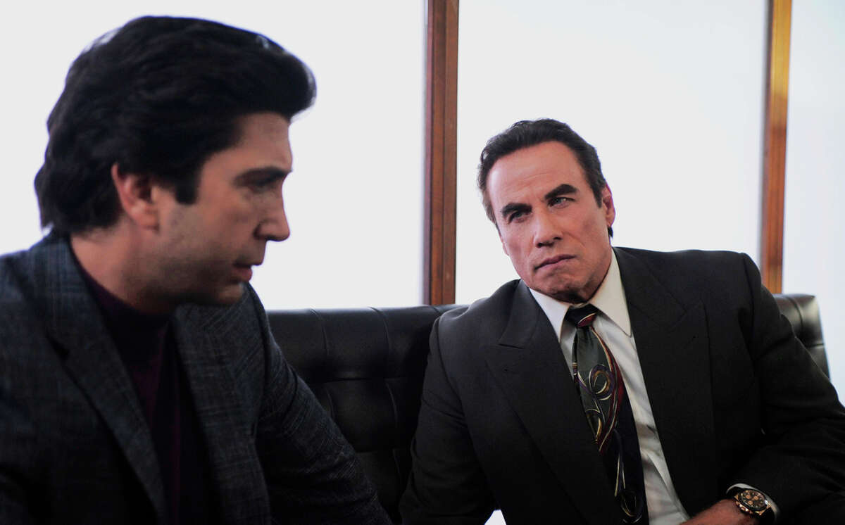 Top: Cuba Gooding Jr. (left) as O.J. Simpson, Joseph Buttler as a polygraph examiner. Above: David Schwimmer (left) as Robert Kardashian, John Travolta as Robert Shapiro.