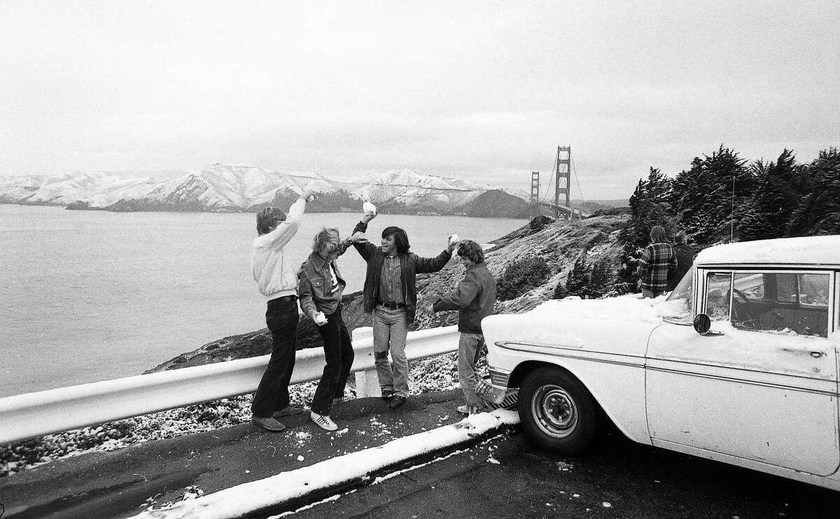 Feb. 5, 1976: Children play with snowballs in front of a beautiful view of the Golden Gate Bridge during a rare San Francisco snowfall in 1976.
