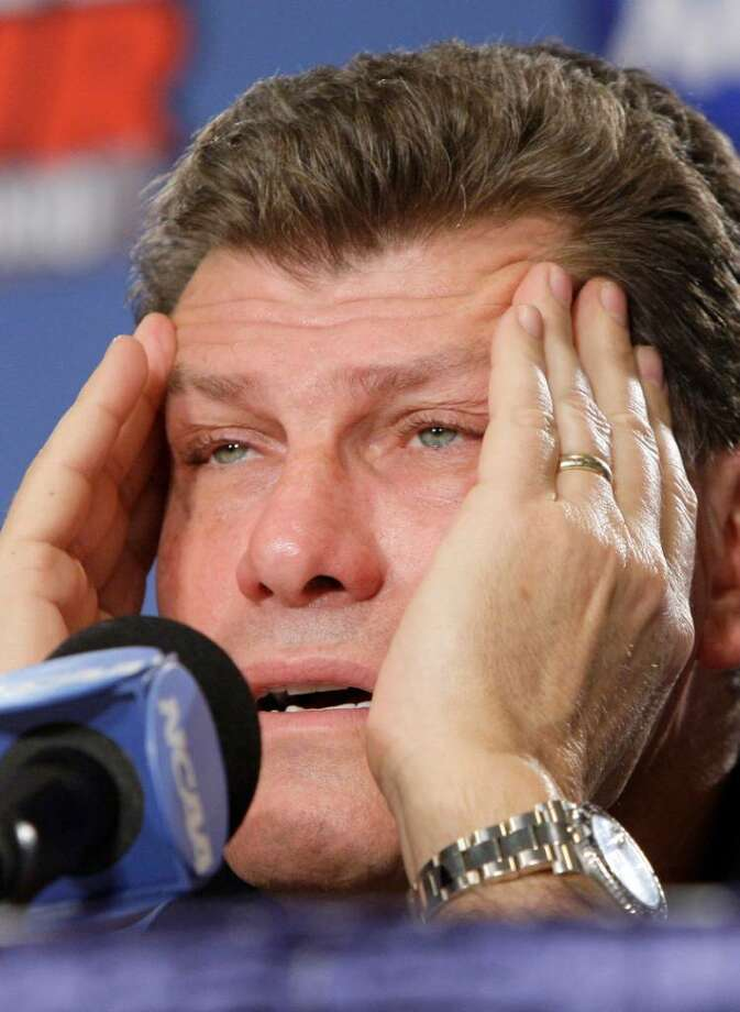 Connecticut coach Geno Auriemma rubs his temples as he responds to questions during a media session at the NCAA Women's Final Four college basketball tournament Monday, April 5, 2010, in San Antonio, Texas. Stanford plays Connecticut for the national championship Tuesday night. Photo: Pat Sullivan